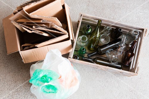 Waste separation: paper, empty glass bottles and plastic rubbish