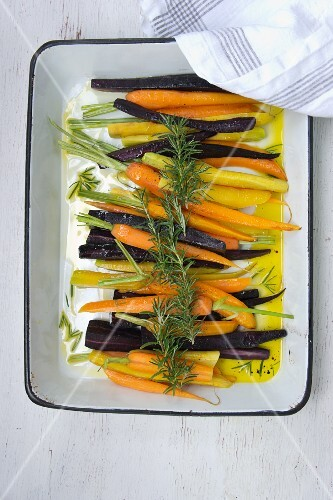 Glazed carrots in a roasting tin
