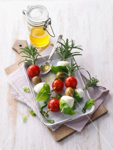 Tomato and mozzarella skewers with rosemary and basil