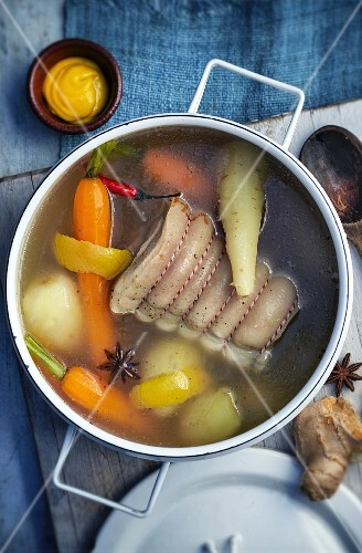 Pork belly with vegetables and spices in a pot