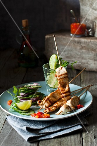 Chicken skewers with cucumber salad and chilli sauce
