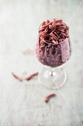 Red wine pasta in a wine glass