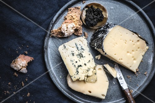 A cheese platter with caviar and bread (seen from above)