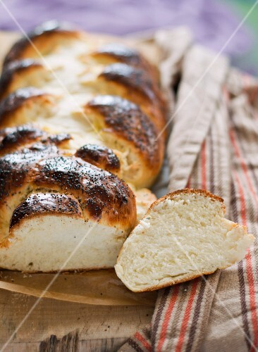 A plaited loaf sprinkled with icing sugar