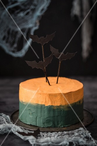 A bi-coloured Halloween cake decorated with bats