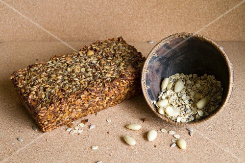 Homemade seed and nut bread with ingredients