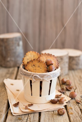 Sables with hazelnuts in a wooden basket