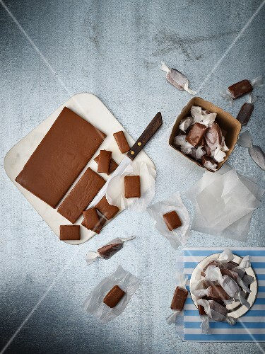 Caramel bonbons being cut and packaged