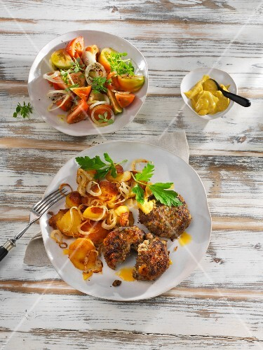 Meatballs with fried potatoes and mustard