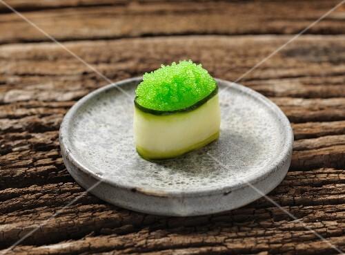 Gunkan maki sushi with green caviar