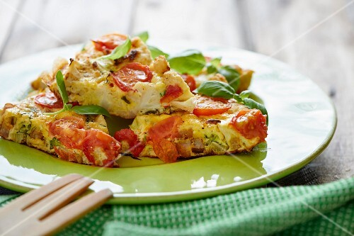 Tortilla with bacon, cauliflower and tomatoes