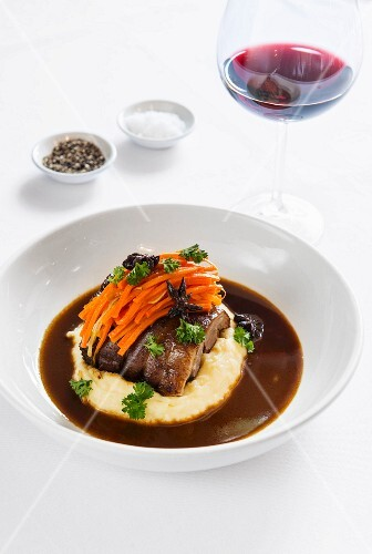 Braised collar of lamb with ginger carrots, mashed potatoes and a sweet and sour sauce