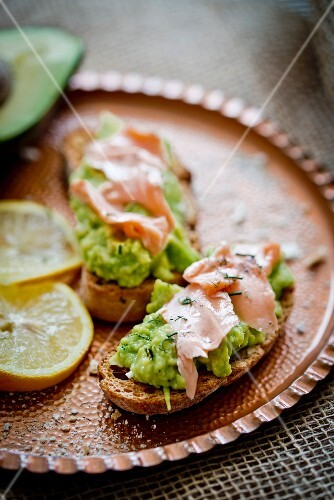 Bruschetta topped with salmon and avocado