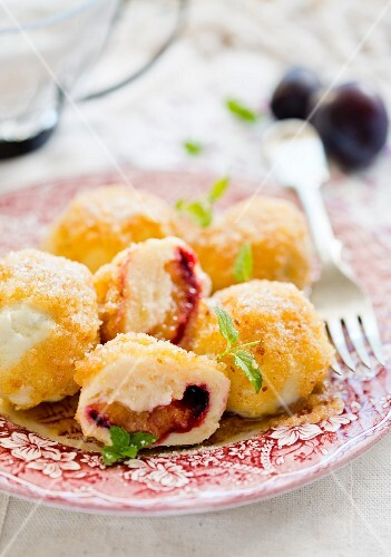 Damson dumplings with buttered crumbs