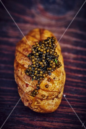A baked potato with caviar