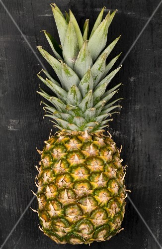 A pineapple on a black surface