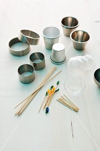 Various kitchen utensils: metal rings, moulds and wooden sticks