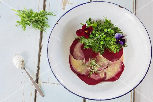 Beetroot carpaccio with a herb salad