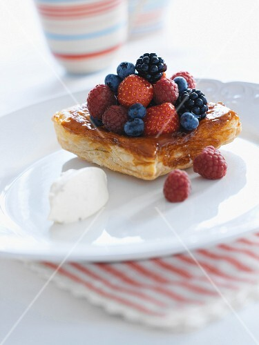 A puff pastry with strawberries, blueberries and raspberries