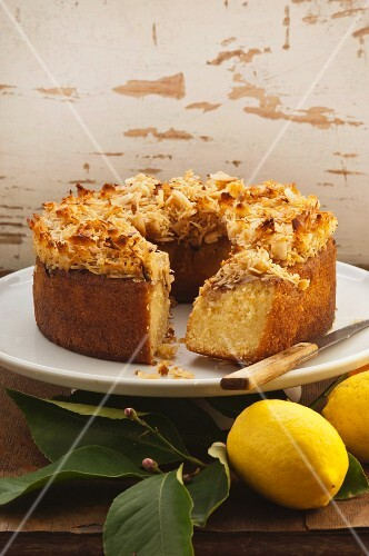 Citrus cake topped with grated coconut, sliced