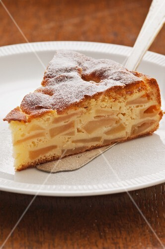 A slice of French apple cake on a cake slice
