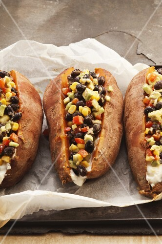 Stuffed sweet potatoes with sweetcorn and beans
