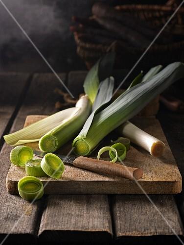 Fresh leeks on a wooden chopping board