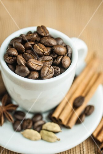 Coffee beans in a cup with spices