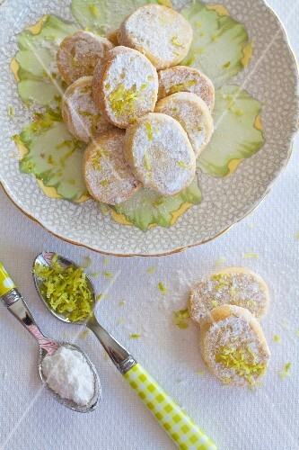 Shortbread biscuits with lime zest in a cup