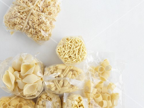 Various types of pasta in plastic bags
