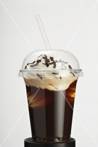 An iced coffee with whipped cream to go