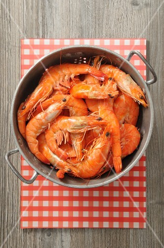 Fresh prawns in a colander