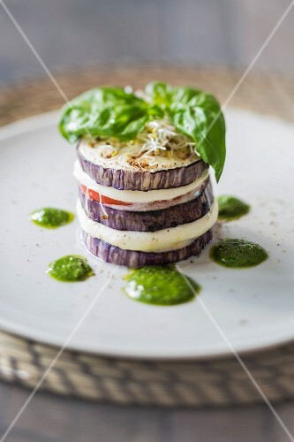 An aubergine tower with mozzarella, tomatoes and basil