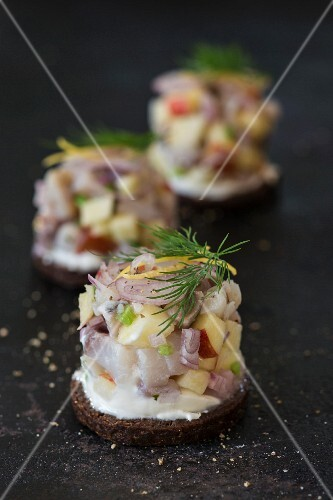 Soused herring salad on pumpernickel