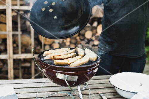 Halibut steaks being smoked in a kettle grill