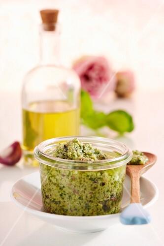 A jar of basil and rose pesto