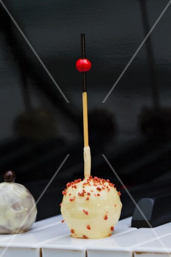 A white chocolate praline on a stick