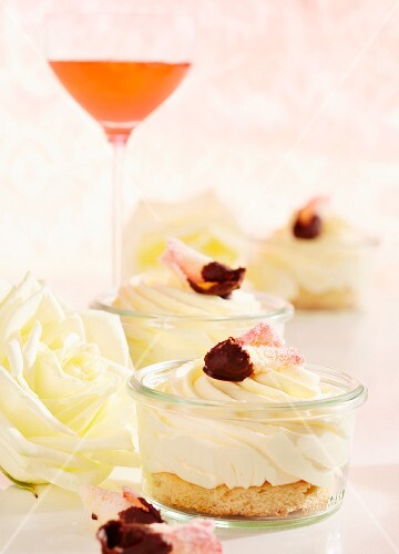 Rose and vanilla cream on sponge cake with candied rose petals