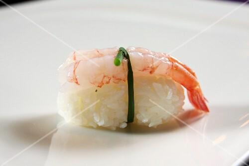 An ebi sushi: nigiri sushi with a prawn