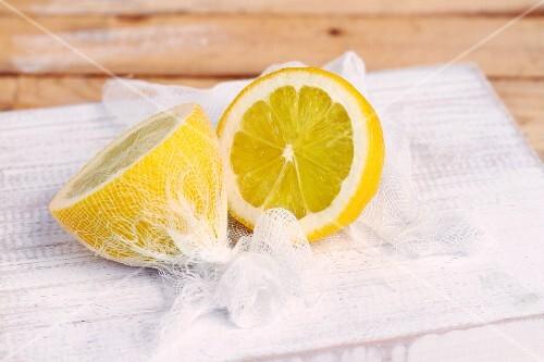 Lemon halves wrapped in muslin