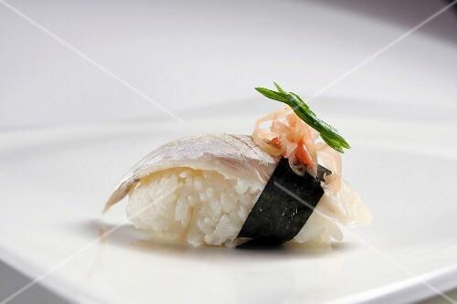 Nigiri sushi with fish, nori and ginger