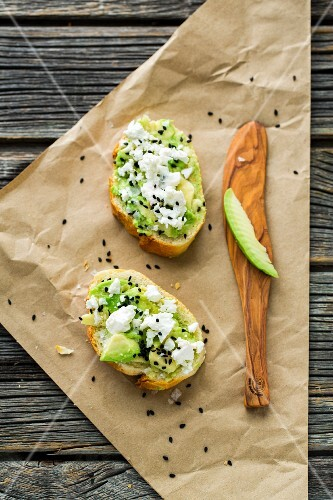 Baguettes with avocado, feta cheese, black sesame seeds and fleur de sel