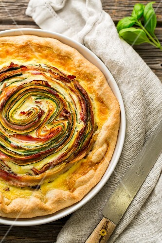 A rose tart with courgette, carrots and bacon