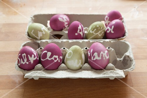 Dyed Easter eggs labelled with wax-resist names