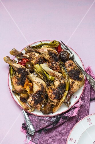 Crispy roast chicken legs with spring onions and peppers