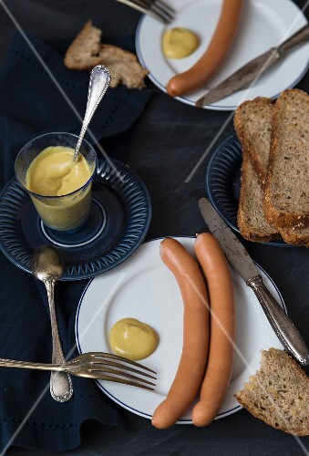 Hot dog sausages with mustard and bread