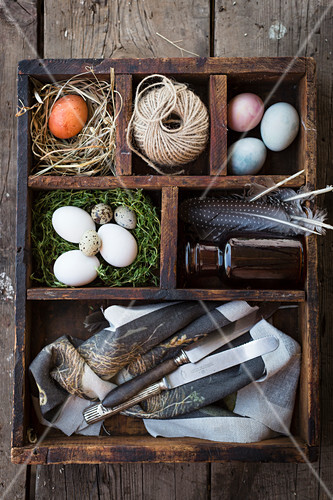 Easter decorations in a wooden box (top view)