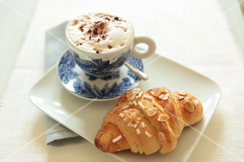 Cappuccino and an almond croissant