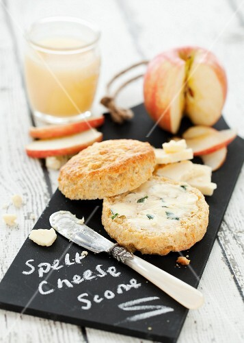 A cheese scone with herb butter, cheese and apple