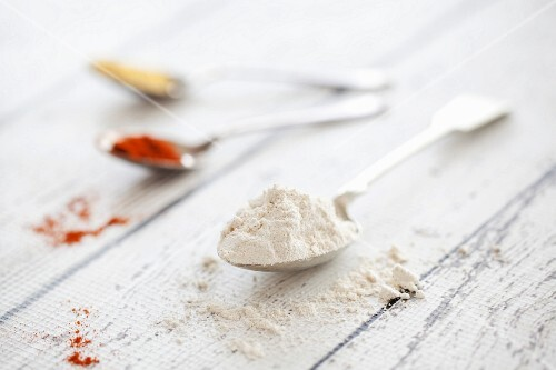 Spelt flour, mustard powder and ground paprika on spoons